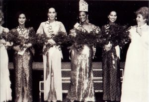 Top Five at Miss Continental 1982 when Tiffany Andretta Arieagus won. Left to Right: Shawna Reese Steel (4th Alternate and barely in photo) , Cherine Alexander (3rd Alternate), Andrea Nicole (2nd Alternate), Tiffany Arieagus (Winner), Dina Jacobs (1st Alternate) and Miss Continental Pageant owner Jim Flint (AKA Felicia).