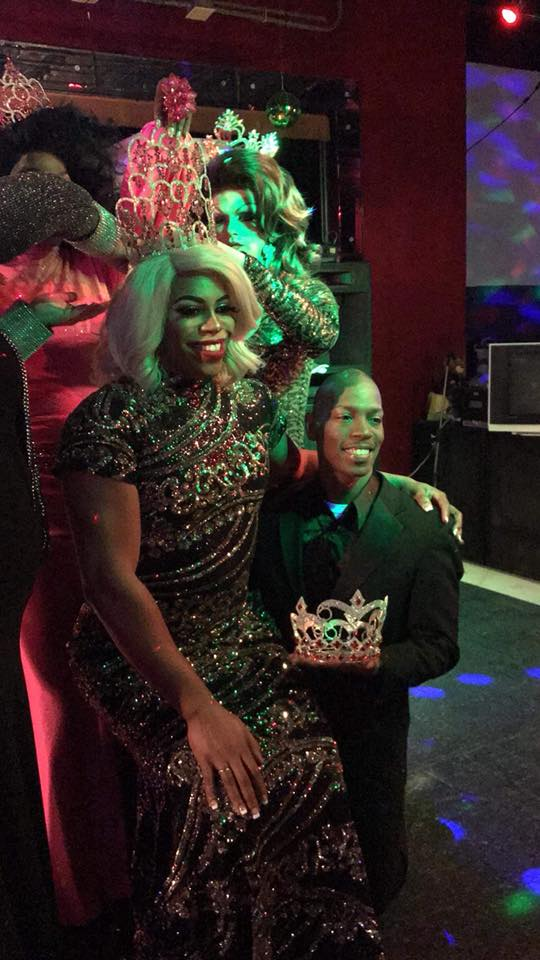 Mykel Knight-Addams Iman St. James (Mr. Cabaret Sweetheart 2018) lends a knee as Giselle Cassidy Carter is crowned Miss Cabaret Sweetheart 2018 at Club Cabaret in Hickory, North Carolina.