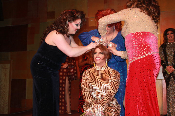 Alli Katt being crowned Miss Gay Capital City America 2010 at Axis Night Club in Columbus, Ohio. Assisting with the crowning include Tiffanie Taylor (in black dress) and Hellin Bedd (in blue dress).