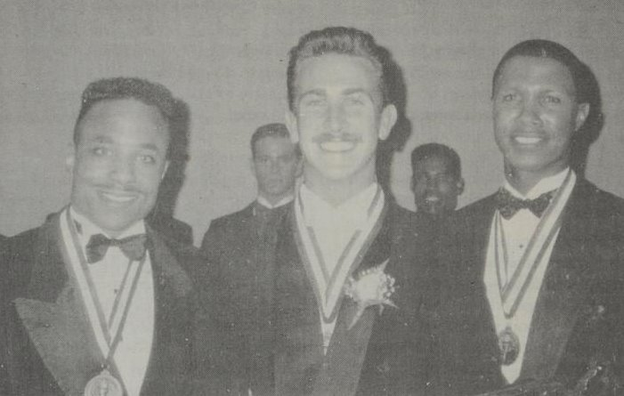 Newly-named Mr. Gay All-American 1992 John Michael Gordon poses with his court, first alternate Kenny Jackson (left) and second alternate Ron Foster (right, competing as Mr. Mid-West but also a former Mr. Gay Arkansas All-American.)
