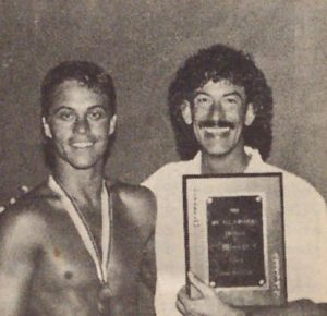 Mr. Gay Indiana All-American promoter Cleo Brasher congratulates his contestant, Mr. Gay Indiana Brad Bemis, on taking the national title as Mr. Gay All-American 1988.