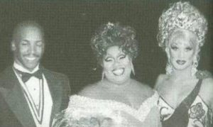Newly-crowned Miss Gay Texas America 1998 Kofi is congratulated by Mr. Gay All-American 1998 Antonio Edwards and Miss Gay America 1997 Lauren Taylor (MGTX 96.)