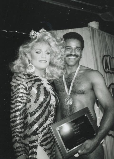Moments after claiming the title of Mr. Gay All-American 1987, Medwin Johnson is congratulated by then-reigning Miss Gay America 1986, Lauren Colby.