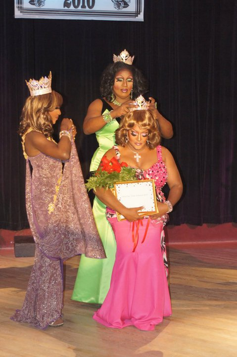 Gizelle Bevon Ashton being crowned Miss Gay Texas America 2010 by Onyx (Miss Gay Texas America 2009). Coco Montrese (Miss Gay America 2010) is a assisting (left).