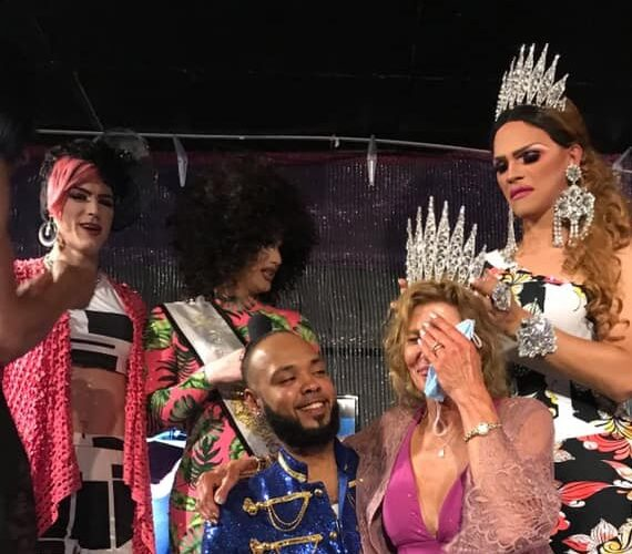 Connie on the knees of Isaac Ismael is crowned Miss Southbend Emeritus by Ava Aurora Foxx. In the back are Electra Lites and Mimi Sharp | Southbend Tavern (Columbus, Ohio) | 6/27/2020 CROPPED