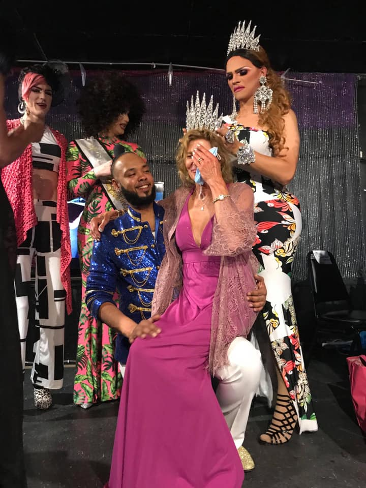 Connie on the knees of Isaac Ismael is crowned Miss Southbend Emeritus by Ava Aurora Foxx. In the back are Electra Lites and Mimi Sharp | Southbend Tavern (Columbus, Ohio) | 6/27/2020