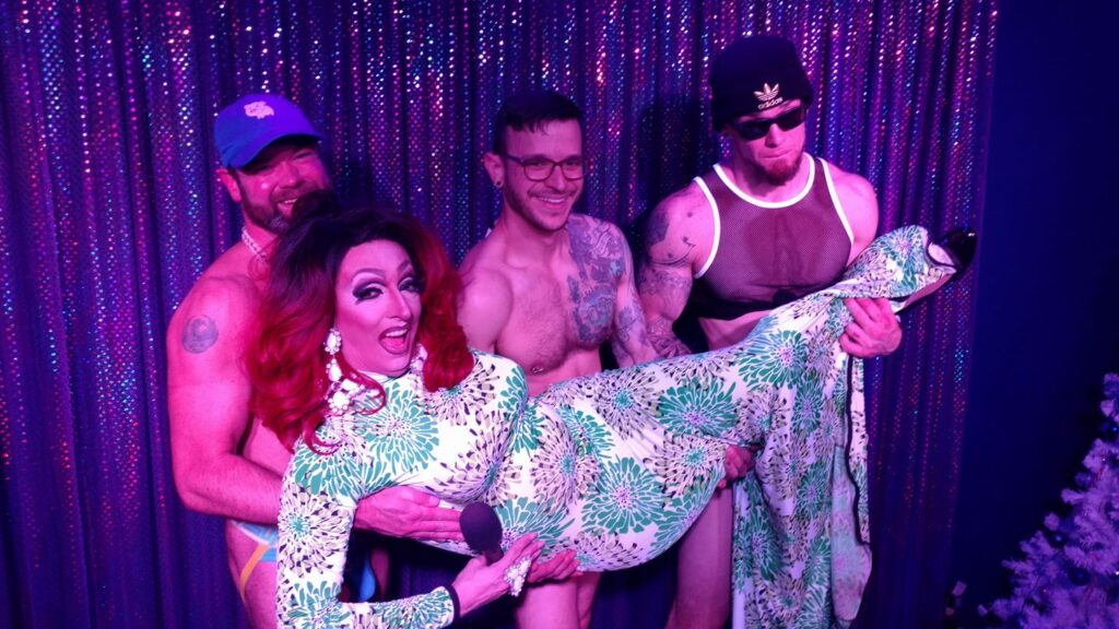 Topher Phoenix, Johnny Dangerously and Trey Russell holding show host Samantha Rollins | Boscoe's (Columbus, Ohio) | January 2018