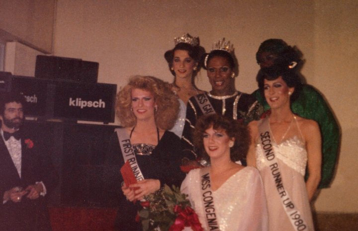 Don Wagner (Pageant Director) is far left. Left to right in the group at the front is Cote' Rossmore, Lana Eastman and Misha Denuve. In the back are Amber Richards, Starr LaSalle and someone who still needs identified. | Miss Gay Indiana America | The Hunt & Chase (Indianapolis, Indiana) | Circa 1980