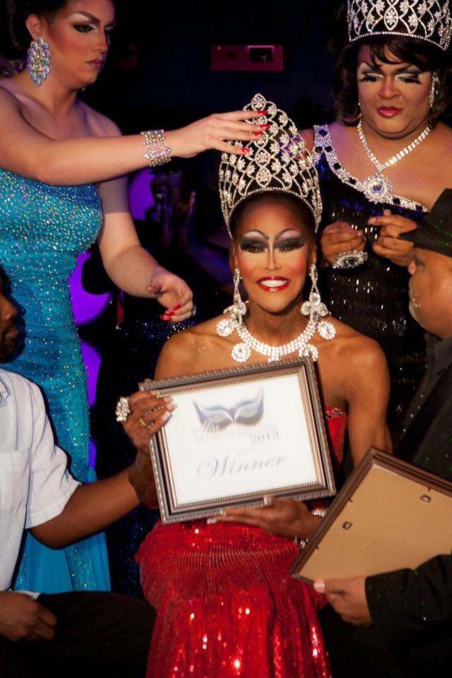 Misty Knight is being crowned by Hope Sexton and Daray Lorez.  To the right of Misty is Rob Austin. | Miss Masque | Masque (Dayton, Ohio) | Circa 2013