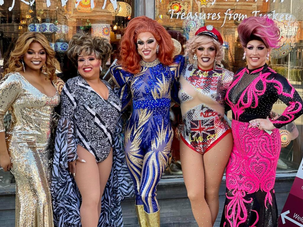 Zhané Dawlingz, Coco Vega, Deva Station, Valerie Taylor and Courtney Kelly pose in front of the Karavan store across the street from Union Cafe as the girls were getting ready at the nearby Axis Nightclub. | January 2021